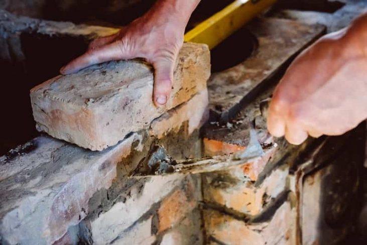 worker repairing a broken firebox
